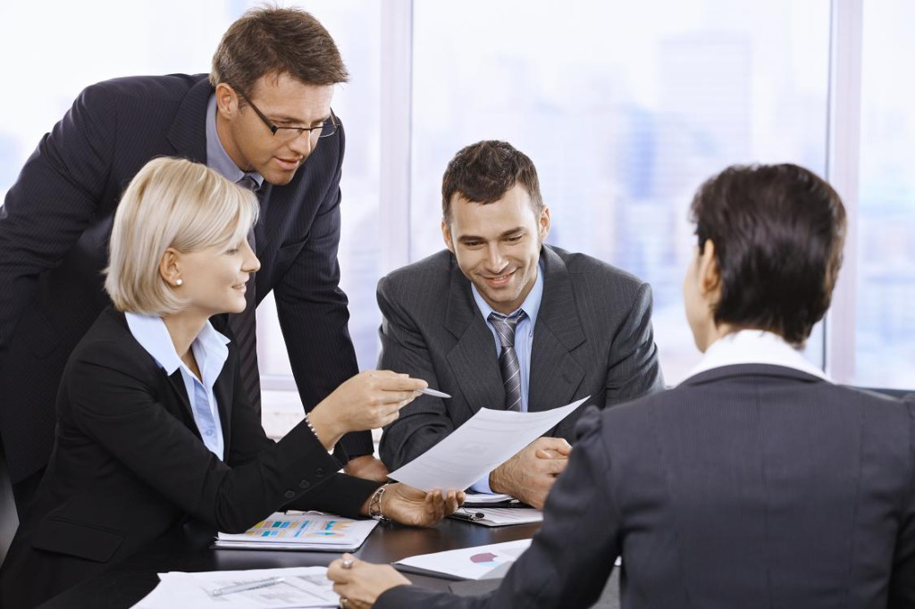 Businesspeople working in office