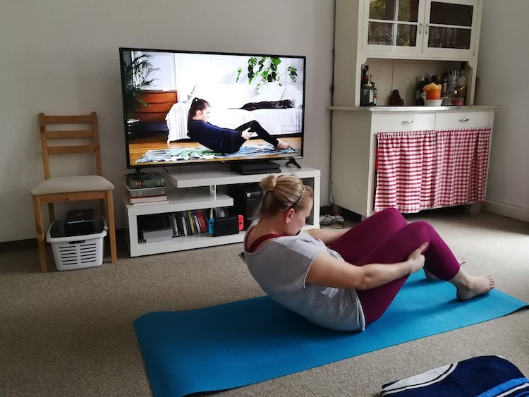 Woman doing yoga workout at home with ott app