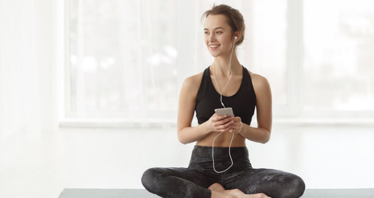 Woman Practicing yoga while listening to music