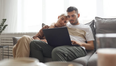 Couple watching videos on a laptop